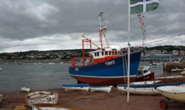 Fishing boat under repair on Teignmouth river beach